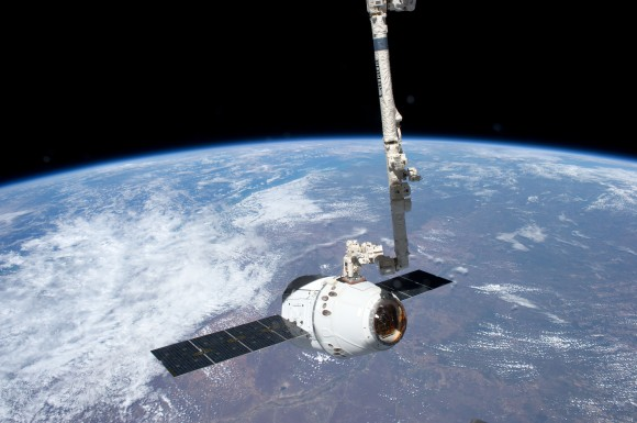 ISS-31_SpaceX_Dragon_spacecraft_is_grappled_by_Canadarm2